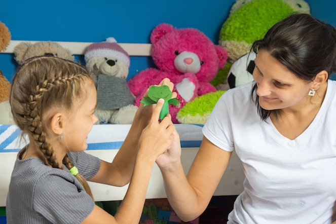 Young Girl and Play Therapist with Finger Puppets